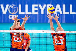 Milan Rasic of ACH and Andrej Flajs of ACH during volleyball match between ACH Volley Ljubljana and Bre Banca Lannutti Cuneo (ITA) in Playoff 12 game of CEV Champions League 2012/13 on January 15, 2013 in Arena Stozice, Ljubljana, Slovenia. (Photo By Vid Ponikvar / Sportida.com)