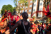 A man is kept in a chain by a fellow dancer as part of the parade. The Notting Hill Carnival has been running since 1966 and is every year attended by up to a million people. The carnival is a mix of amazing dance parades and street parties with a distinct Caribbean feel.