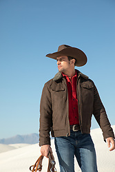 handsome cowboy in a Winter coat outdoors
