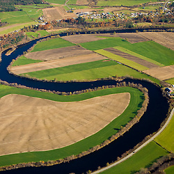 The Connecticut River flows through farmland in Newbury, Vermont and Haverhill, New Hampshire.  Aerial.
