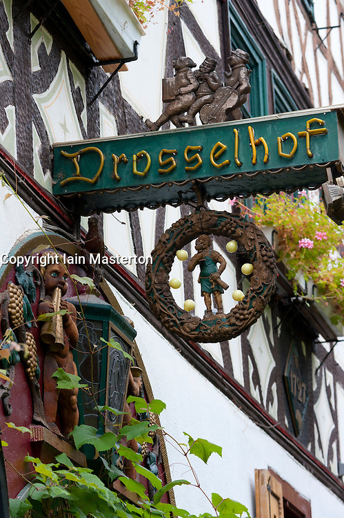 Detail of restaurant sign in famous tourism Drosselgasse Street in popular town of Rudesheim on River Rhine in Germany