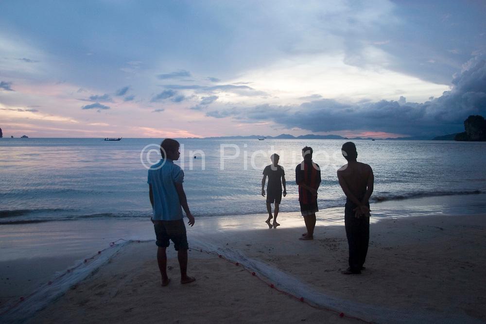 Waiting for fish at sunset in the Andaman Sea at Railay West Bay, Railay.