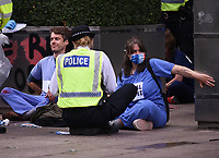 Extinction Rebellion glue themselves to ground and the JP Morgen at the Canary Wharf photos by Krisztian Elek