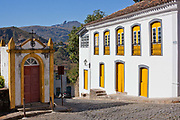 Colourful Colonial buildings in the city centre of Ouro Preto, in the state of Minas Gerais, Brazil. Ouro Preto, meaning black gold, was an important mining town especially during the Brazilian gold rush in the 1700s. It is now a UNESCO heritage site due to the excellent examples of Baroque architecture.