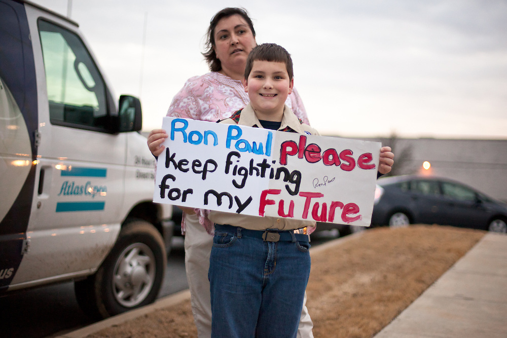 A boy scout stands with is mother holding a sign in support of Ron Paul in Rock Hill, SC.