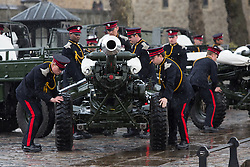 © Licensed to London News Pictures. 21/04/2014. London, UK. Members of the Honourable Artillery Company (HAC) wheel in light guns during a rain shower ahead of a 62 Gun Salute in honour of Her Majesty the Queen's 88th birthday today, 21st April 2014 at the Tower of London in front of Tower Bridge in London.. Photo credit : Vickie Flores/LNP