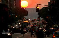 The sun sets down 34th Street in Manhattan 5/28/06.
