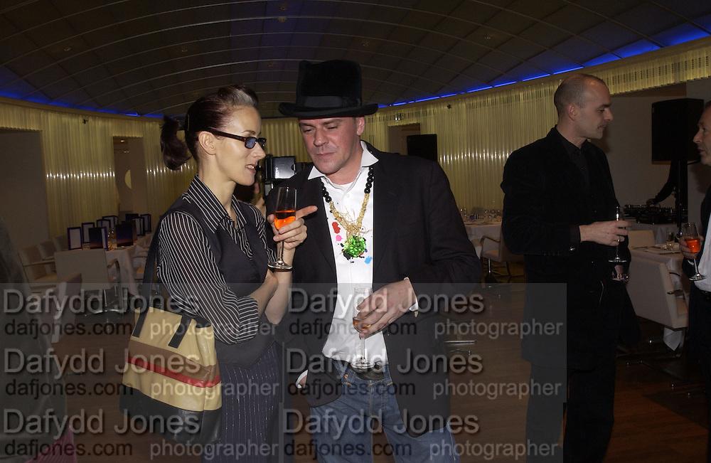 Karen Franklin and Judy Blame, I.D. magazine dinner for John Dempsey of Mac cosmetics, Fifth floor restaurant, Harvey Nichols. 17 December 2002. © Copyright Photograph by Dafydd Jones 66 Stockwell Park Rd. London SW9 0DA Tel 020 7733 0108 www.dafjones.com