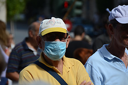 October 3, 2016 - Athens, Greece - Demonstrators use masks after the tear gass attack by police..Greek pensioners demonstrate in Athens against the goverment cuts on pensions and their benefits in General. Demonstrators clashed with riot policve after they found the road to Prime Ministers office closed by police. (Credit Image: © George Panagakis/Pacific Press via ZUMA Wire)