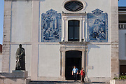 A couple leave the Igreja Paroquial da Vera Cruz (church) after Sunday evening Mass, in Aveiro, Portugal.