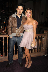 OLIVIER MARTINEZ and DAYA FERNANDEZ at a party to celebrate the launch of Hollywood Domino - a brand new board game, held at Mosimann's 11b West Halkin Street, London on 7th November 2008.  The evening was in aid of Charlize Theron's Africa Outreach Project.
