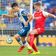 BARCELONA, SPAIN - August 18:  Luuk De Jong #19 of Sevilla challenged by Marc Roca #21 of Espanyol during the Espanyol V  Sevilla FC, La Liga regular season match at RCDE Stadium on August 18th 2019 in Barcelona, Spain. (Photo by Tim Clayton/Corbis via Getty Images)