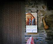 An entry door of Rio Onor village. The rural life of Rio Onor saved the villagers from the economical crisis.