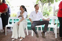 Singer, Rihanna and Prince Harry prepare for an live HIV test, in order to promote more widespread testing for the public, at the 'Man Aware' event held by the Barbados National HIV/AIDS Commission in Bridgetown, Barbados, during his tour of the Caribbean.