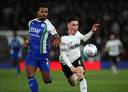 Wigan Athletic's Nathan Byrne and Derby County's Harry Wilson battle for the ball during the Sky Bet Championship match at Pride Park, Derby.