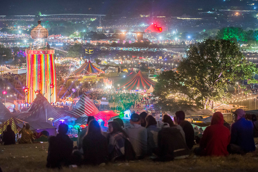 Early friday morning from the hill looking past the Park Tower - The 2017 Glastonbury Festival, Worthy Farm. Glastonbury, 23 June 2017