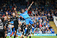 Peterborough United forward Ivan Toney (17) gets muscled out of this header during the EFL Sky Bet League 1 match between Peterborough United and Portsmouth at London Road, Peterborough, England on 15 September 2018.