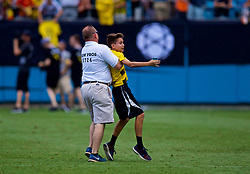 CHARLOTTE, USA - Sunday, July 22, 2018: An overly aggressive steward violently restrains a young supporter who wanted an autograph from Borussia Dortmund Christian Pulisic after a preseason International Champions Cup match between Borussia Dortmund and Liverpool FC at the  Bank of America Stadium. (Pic by David Rawcliffe/Propaganda)