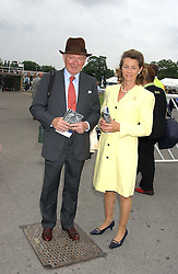 MR & MRS BARRY HILLS he is the race horse trainer at the King George VI and The Queen Elizabeth Diamond Stakes sponsored by De Beers held at Newbury Racecourse, Berkshie on 23rd July 2005.<br /><br />NON EXCLUSIVE - WORLD RIGHTS