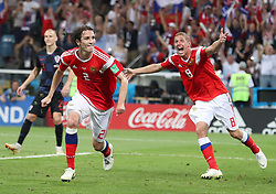 SOCHI, July 7, 2018  Mario Fernandes (C) of Russia celebrates scoring with teammate during the 2018 FIFA World Cup quarter-final match between Russia and Croatia in Sochi, Russia, July 7, 2018. Croatia won 6-5 (4-3 in penalty shootout) and advanced to the semi-finals. (Credit Image: © Yang Lei/Xinhua via ZUMA Wire)
