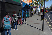 At the beginning of the fourth week of the UK governments lockdown during the Coronavirus pandemic, and with 120,067 UK reported cases with 16,060 deaths, a local bank users practice social distancing in a queue for the Natwest Bank in Camberwell in South London, on 20th April 2020, in London, England.