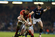 Taulupe Faletau of Wales © is held up. RBS Six nations championship 2016, Wales v Scotland at the Principality Stadium in Cardiff, South Wales on Saturday 13th February 2016. <br /> pic by  Andrew Orchard, Andrew Orchard sports photography.