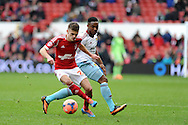 Nottingham Forest's Jamie Paterson goes past West Ham's Matthias Fanimo. FA Cup with Budweiser, 3rd round, Nottingham Forest v West Ham Utd match at the City Ground in Nottingham, England on Sunday 5th Jan 2014.<br /> pic by Andrew Orchard, Andrew Orchard sports photography.