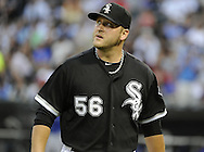 CHICAGO - JUNE 21:  Mark Buehrle #56 of the Chicago White Sox looks on against the Chicago Cubs on June 21, 2011 at U.S. Cellular Field in Chicago, Illinois.  (Photo by Ron Vesely)  Subject:  Mark Buehrle