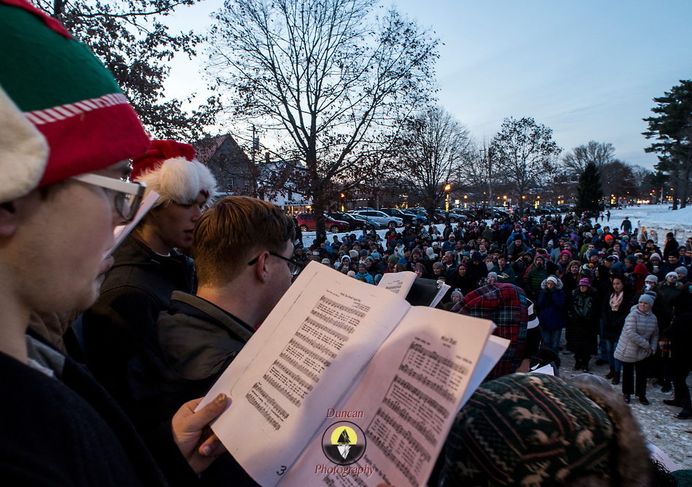 BRUNSWICK, Maine  11/24/18 -- Cole Engstrom, 18, sings Christmas carols with the Brunswick High School chorus at Brunswick's tree lighting event on Saturday.  <br /> Photo by Roger S. Duncan for the Forecaster
