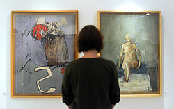 "© Licensed to London News Pictures. 15/11/2012. London, UK A woman looks at two David Hockney Paintings from his time at the College. (L ""Composition - Thrust"" and R ""Nude-Seated"" both completed in 1962 Hockney was a Painting student 1959-62)  The Royal College of Art is celebrating its 175th anniversary with a major exhibition featuring more than 350 works of art and design by over 180 RCA graduates and staff, including Henry Moore, Barbara Hepworth, Tracey Emin, David Hockney, Peter Blake, Bridget Riley and Lucian Freud.  The RCA is the world's oldest art and design university in continuous operation. Its first students comprised a small group of teenage boys; today it educates some 1,200 postgraduate students from 55 different countries.. Photo credit : Stephen Simpson/LNP"