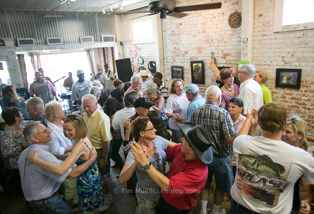Cheryl Green and John Dupesko, center couple, dance at Cafe Des Amis as Corey Ledet and his Zydeco band perform Saturday morning during the cafe's weekly zydeco breakfast in Breaux Bridge, Louisiana.