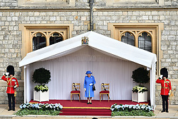 Queen Elizabeth II waits to greet US President Donald Trump ahead of his arrival at Windsor Castle, Windsor.