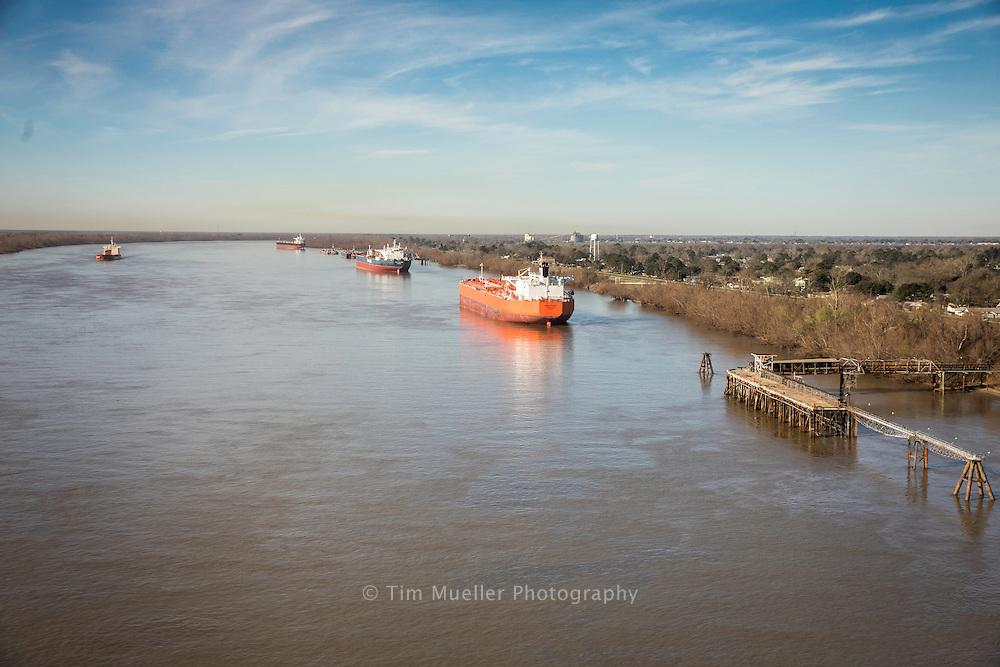 Cargo ships anchor on the Mississippi River near Lutcher, La. The Mississippi River is a natural transportation network with nearly 6,000 vessels and 500 million tons of cargo traveling up and down the river each year.