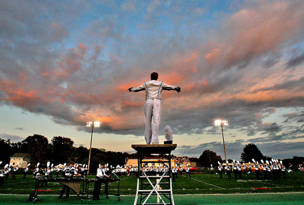 Clear Creek-Amana high school drum major Fritz Burgher directs the band during the Marion Marching Invitational on Saturday, September 26, 2009. The competition was one of three other band contests taking place in the area. The others were held at Linn-Mar and Prairie High. (Crystal LoGiudice/The Gazette). ..REFER: See gazetteonline.com for more photos from the Marion Marching Festival.