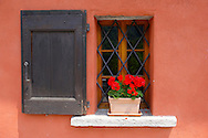 Couorful geramiuns in a rustic window - Val Verzasca - Ticino - Switzerland .<br /> <br /> Visit our SWITZERLAND  & ALPS PHOTO COLLECTIONS for more  photos  to browse of  download or buy as prints https://funkystock.photoshelter.com/gallery-collection/Pictures-Images-of-Switzerland-Photos-of-Swiss-Alps-Landmark-Sites/C0000DPgRJMSrQ3U