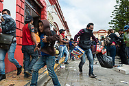 On a day in which protests where held across Mexico protesting the government's handling of and involvement in the disappearance of 43 students on September 26, 2014 in Iguala, Guerrero, Mexico, youth ransack and loot an OXXO convenience store in San Cristobal de las Casas, Mexico.