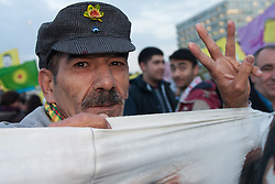 Westminster, October 9th 2014. A Kurdish protester gives the sign of the Kurdish PKK as scores of Kurds demonstrate against ISIS and demand that the UK and Turkey assist them in defending themselves against the Jihadist movement.