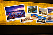 Electronic display of holiday destination images at Stansted airport, Essex, England
