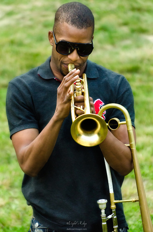 Trombone Shorty warming up on his trombone and trumpet just prior to taking the stage at The Appel Farm's 2011 Arts & Music Festival in Elmer, NJ.