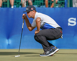 January 11, 2019 - Honolulu, HI, U.S. - HONOLULU, HI - JANUARY 11: Gary Woodland lines up his putt on the 18th hole during the second round of the Sony Open at the Waialae Country Club in Honolulu, HI. (Photo by Darryl Oumi/Icon Sportswire) (Credit Image: © Darryl Oumi/Icon SMI via ZUMA Press)