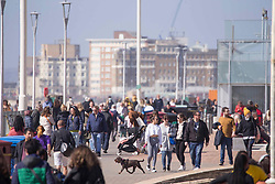 """© Licensed to London News Pictures.29/03/2021. Brighton,UK. Members of the public enjoy spring weather in Brighton, East Sussex. From today (Monday), the """"Stay at Home"""" advice ends with people being allowed to meet up within the 'rule of six'. Photo credit: Marcin Nowak/LNP"""