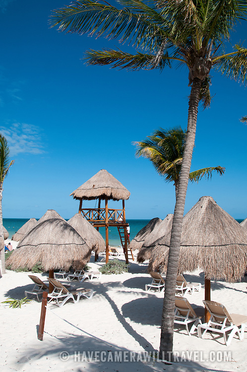 Beach chairs on the idyllic white sandy beach at Excellence Playa Mujeres Resort at Playa Mujeres, north of Cancun, Quintana Roo, Mexico