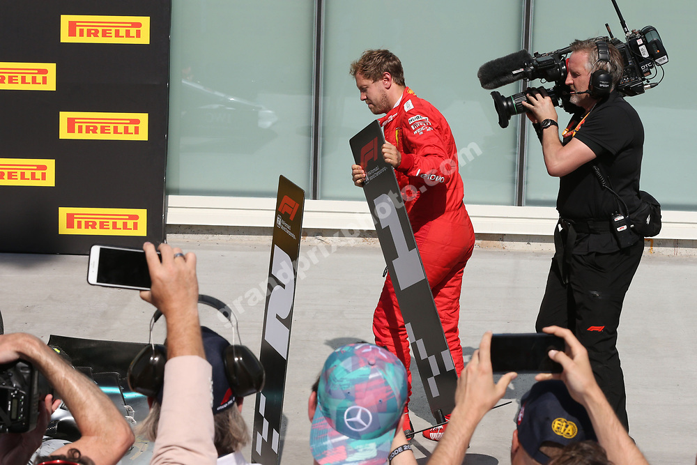 Sebastian Vettel (Ferrari) changes the nummer 1 and 2 signs around in parc ferme after the 2019 Canadian Grand Prix in Montreal. Photo: Grand Prix Photo