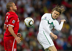 Matt Upson of England vs Zlatko Dedic of Slovenia during the 2010 FIFA World Cup South Africa Group C Third Round match between Slovenia and England on June 23, 2010 at Nelson Mandela Bay Stadium, Port Elizabeth, South Africa.  (Photo by Vid Ponikvar / Sportida)