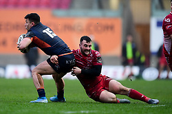 Guinness PRO14, Parc y Scarlets, Llanelli, UK 15/02/2020<br /> Scarlets vs Edinburgh Rugby<br /> Damien Hoyland of Edinburgh Rugby is tackled by Paul Asquith of Scarlets<br /> Mandatory Credit ©INPHO/Ryan Hiscott