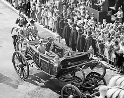 File photo dated 19/07/60 of crowds and policemen on the pavement as they greet King Bhumibol Adulyadej of Thailand and Queen Elizabeth II as they drive from Victoria to Buckingham Palace at the start of his State visit to London, as the Queen has become the world's longest reigning living monarch following the death of King Bhumibol.