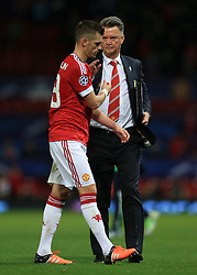 30-9-2015 ENG: UEFA Champions League Manchester United - VfL Wolfsburg, Manchester<br /> Man Utd manager Louis van Gaal shakes hands with Morgan Schneiderlin of Man Utd after the match<br />  Photo: Simon Stacpoole / Offside.<br /> <br /> ***** NETHERLANDS ONLY ******