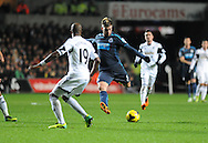 Davide Santon of Newcastle has a shot at goal.<br /> Barclays Premier League match, Swansea city v Newcastle Utd at the Liberty stadium in Swansea, South Wales on Wednesday 4th Dec 2013. pic by Phil Rees, Andrew Orchard sports photography,