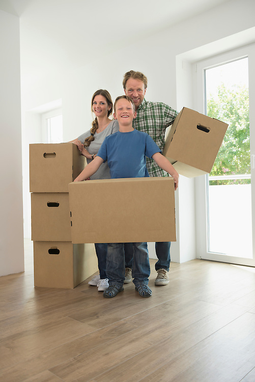 Young family father mother boy moving home