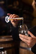 Heather Greene blending whisky in the rickhouse at Milam & Greene Distillery in Blanco, Texas.